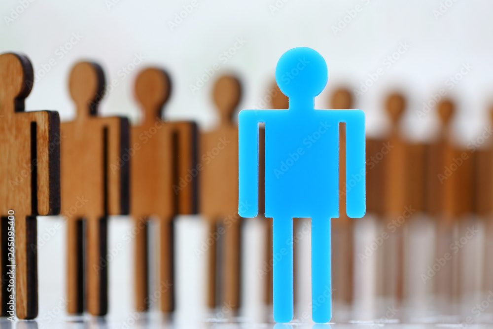 Fototapeta Blue notable human figure step forward in front of row identical fellows