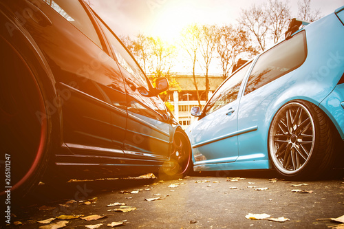 Fotografia, Obraz Two modified low cars in brown and light blue color