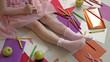 little girl draws on her feet with felt-tip pens, children's creativity, development