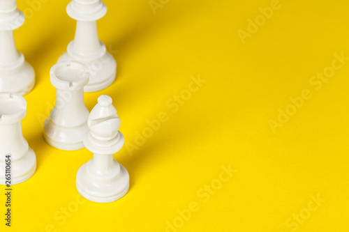 Fotografie, Obraz  Chess figures on yellow background top view copy space