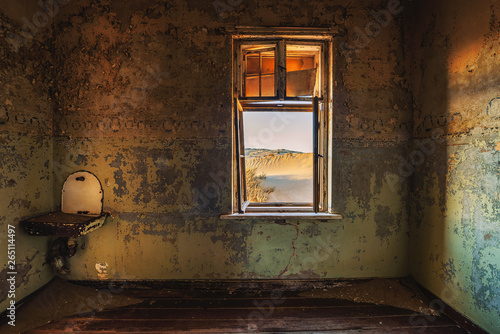 Ruins of the mining town Kolmanskop in the Namib desert near Luderitz in Namibia Canvas Print