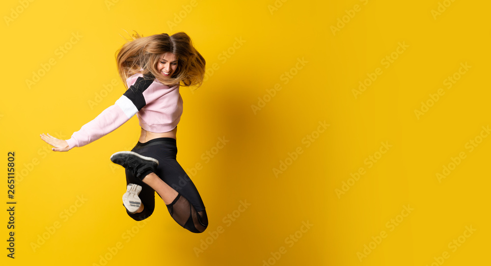 Fototapety, obrazy: Urban Ballerina dancing over isolated yellow background and jumping