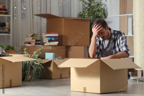Sad evicted man moving home complaining on the floor Wallpaper Mural