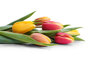 A Side View, Closeup Of A Collection Of Red, Yellow And White Tulip Flowers Isolated On A White Table Top.