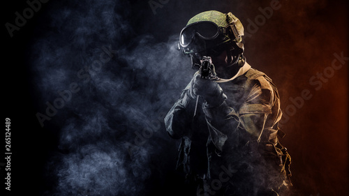 Obraz russian special forces soldier with rifle on dark background. army, military and people concept - fototapety do salonu