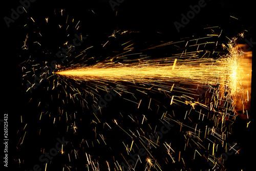 Fotografie, Tablou Glowing Flow of Sparks in the Dark