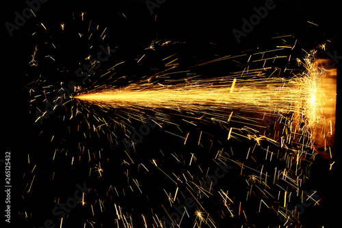 Fotografija Glowing Flow of Sparks in the Dark