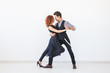 Leinwandbild Motiv Social dance, kizomba, tango, salsa, people concept - beautiful couple dancing bachata on white background with copy space