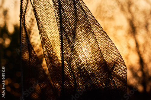 Valokuva  fishing equipment for fish weighing , fishing net against the background of the