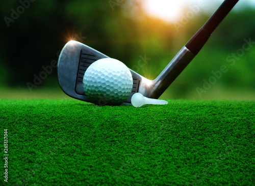 Deurstickers Golf Steel golf ball, ball on white tee, golf ball match equipment In the green lawn in the competition of golf