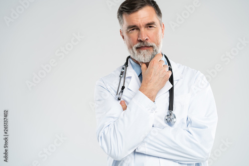 Fototapeta Cheerful mature doctor posing and smiling at camera, healthcare and medicine. obraz