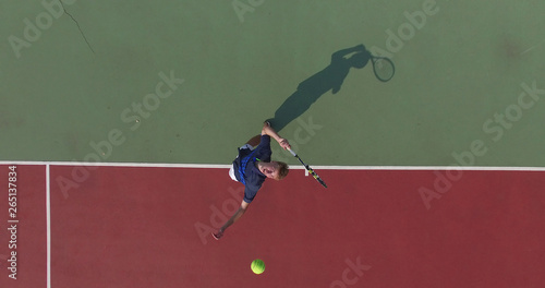 Fotografie, Obraz  Tennis player throws ball into the air to serve