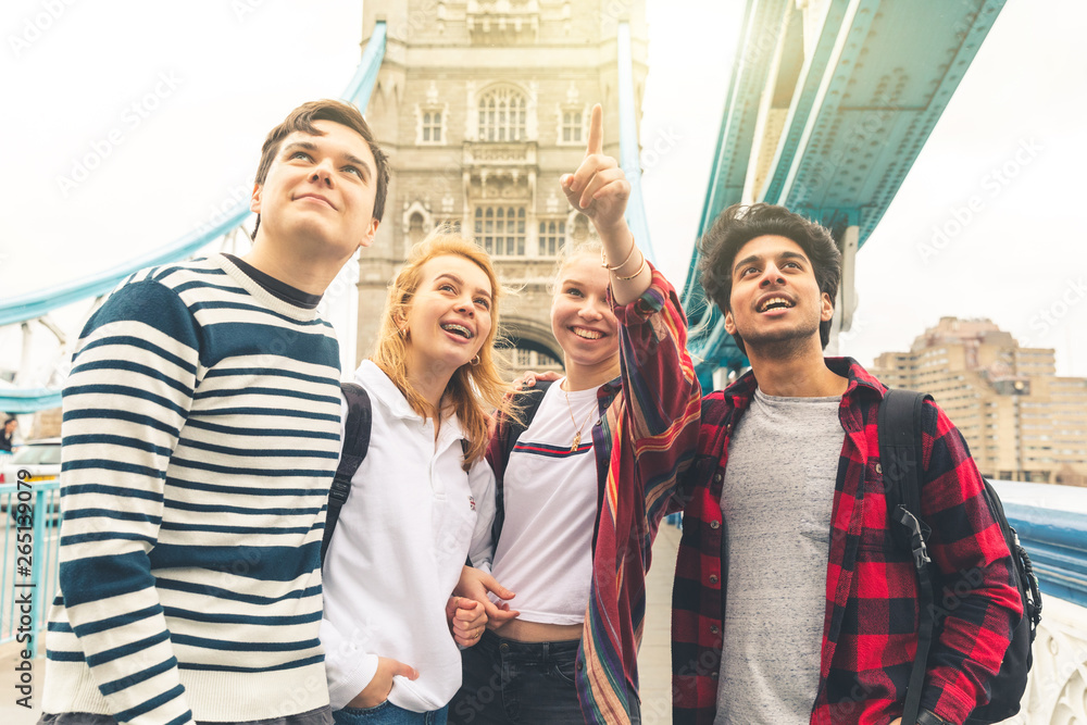 Fototapety, obrazy: Happy students on Tower Bridge in London during school trip