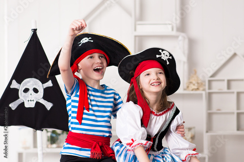 Vászonkép  Boy and girl in pirate costumes, play enthusiastically