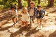 Leinwanddruck Bild - Kids running up in the forest