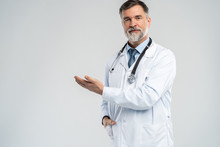 Doctor Senior Man, Medical Professional Holding Something In Empty Hand Isolated Over White Background.