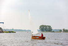 A Sailboat With A Woman Sailing On The Kaag.