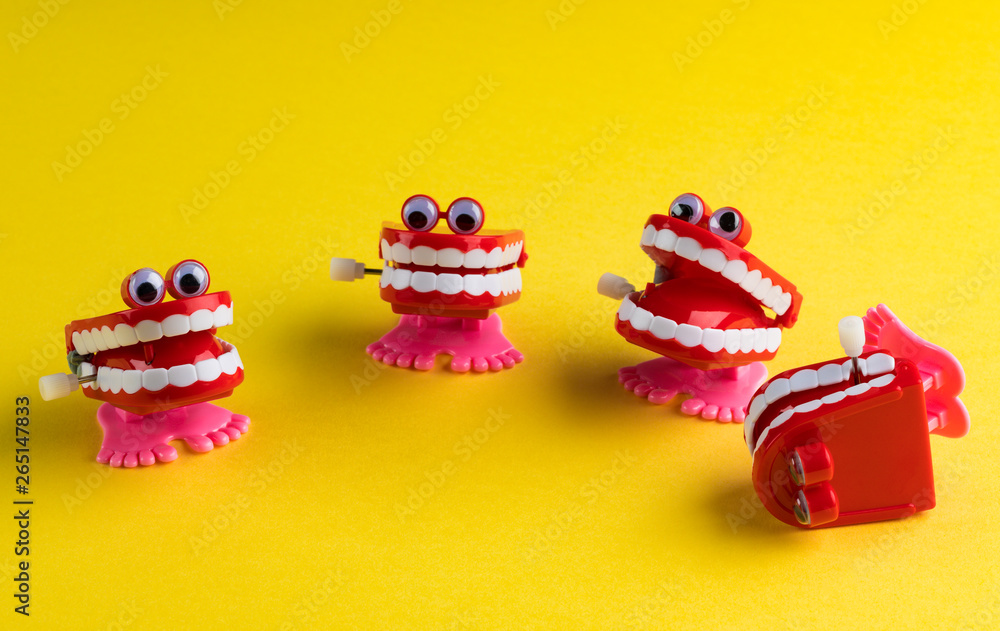 Fototapety, obrazy: Four Clockwork Mouths Laughing One Fell Over on Yellow Background