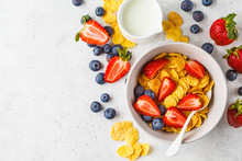 Cornflakes With Strawberries And Blueberries In A Bowl On White Background, Top View.