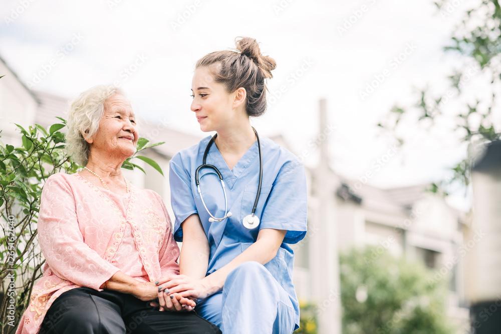 Fototapety, obrazy: caregiver holding hand of happy elderly woman