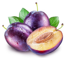 Plums With Water Drops On A Wh...