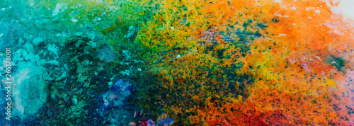 Banner background of colorful Holi powder on the snow