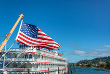 American Flag And Riverboat In Astoria