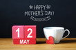 canvas print picture - Happy Mothers Day 12 May message with coffee cup with wooden blocks