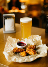 Fried Cheese Snack With Berry Sauce And Glass Of Cold Beer