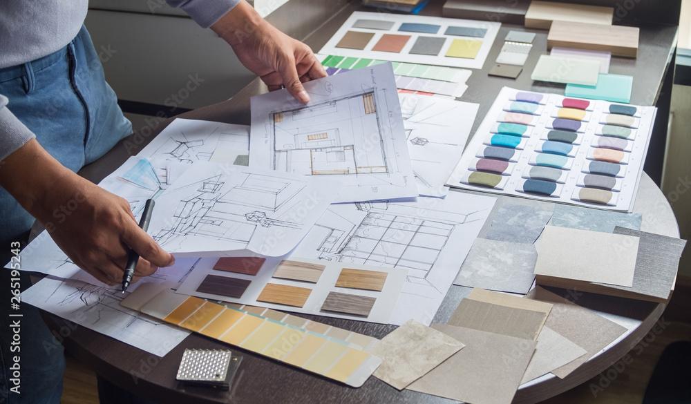 Fototapeta Architect designer Interior creative working hand drawing sketch plan blue print selection material color samples art tools Design Studio