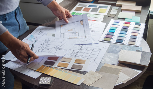 Architect designer Interior creative working hand drawing sketch plan blue print selection material color samples art tools Design Studio - fototapety na wymiar