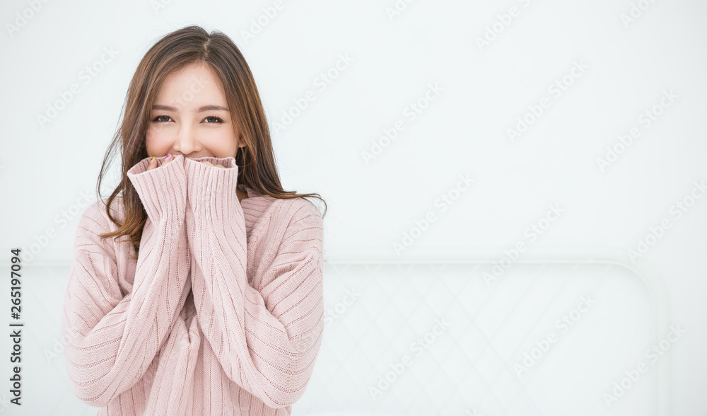 Fototapeta Portrait of young beautiful asian woman in bedroom. Smile happy asian girl hands cover face wear winter cloth. Beauty treatment perfect clear skin japanese makeup  lifestyle concept panoramic banner