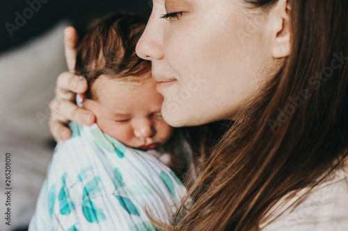 Fototapeta young mother with her newborn baby obraz