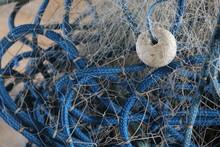 Fisherman Mending Nets