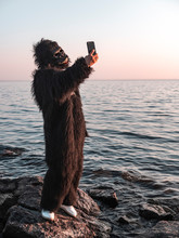 Man In A Monkey Costume Takes ...