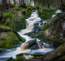 Waterfall Flowing Over Mossy R...