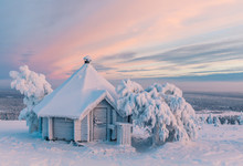 Small Hexagonal Cabin Covered In Snow