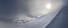 Steep Snowy Slope Under Clouds And Blocked Sun