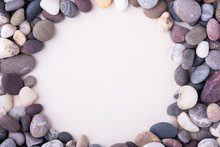 Varied Pebbles On White Background Top View Rounded Frame