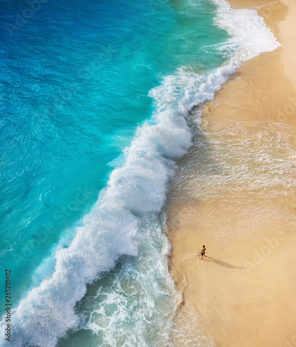 Foto-Schiebegardine Komplettsystem - View of a man on the beach on Bali, Indonesia. Vacation and adventure. Top view from drone at beach, azure sea and relax man. Travel and relax - image