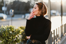 Pretty Woman Smoking On Street