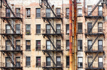 New York City Old Apartment Building With Rusted Metal Pipes