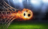 Fototapeta Sport - Fiery Soccer Ball In Goal With Net In Flames