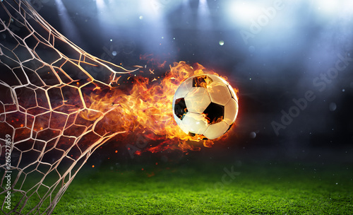 Obraz Fiery Soccer Ball In Goal With Net In Flames - fototapety do salonu