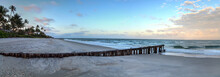 Dawn Over A Dilapidated Pier On The Beach In Port Royal