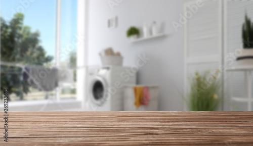 Fotografía  Laundry room interior with washing machine near wall