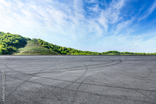 Recess Fitting F1 Empty asphalt race track and beautiful natural landscape