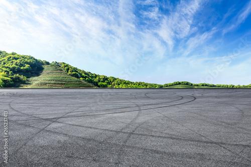 Empty asphalt race track and beautiful natural landscape