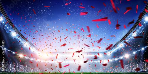 Fototapeta  Football stadium background with flying confetti