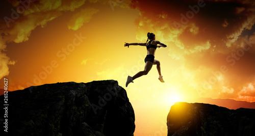 Fotografie, Obraz  Jumping over precipice, challenge concept.